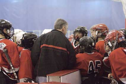 Coach and hockey team
